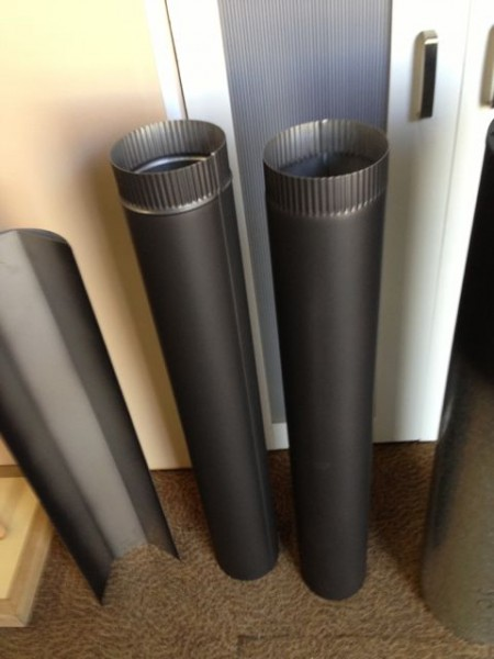 Two Painted Stainless Steel flues. Part of most flue kits. Used as the first two flues out of the heater.