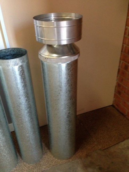 Two 250 MM outer flues and a Rain Hat (Cowl). Part of most flue kits. These two flues are fitted above the Dropbox with the Rain Hat on top.